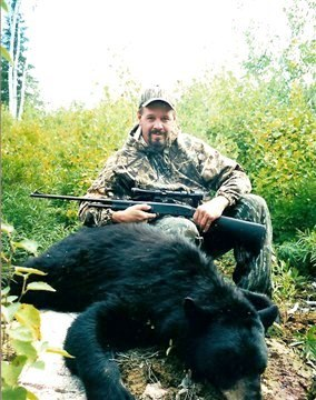 Successful guy hunting bears